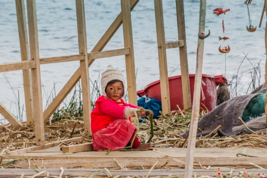 playing little girl on Taquile Island, Peru